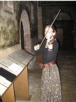 Kira playing travel violin